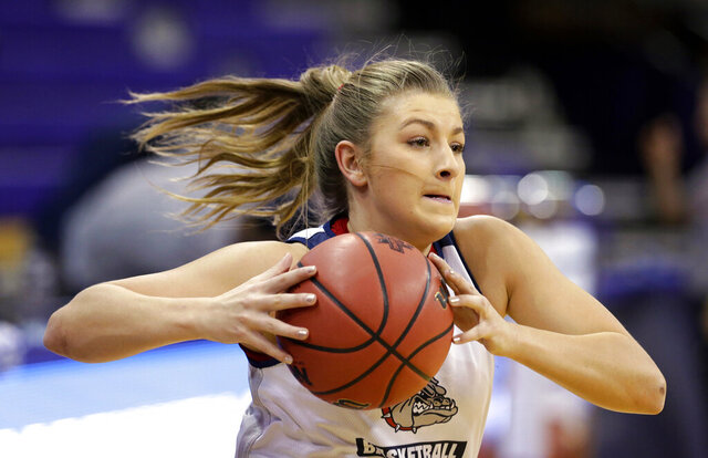 FILE - In this March 17, 2017, file photo, Gonzaga's Laura Stockton runs through a drill during a practice at the NCAA college basketball tournament in Seattle. Stockton sounds perfectly happy to ride buses around Germany if it means she gets to play professional basketball. The 23-year-old daughter of retired Utah Jazz great John Stockton spent the past year-plus rehabbing an ACL injury that ended her collegiate career at Gonzaga. (AP Photo/Elaine Thompson, File)