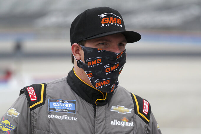 NASCAR Texas Trucks Series driver Sheldon Creed (2) stands on pit road before a NASCAR Cup Series auto race at Texas Motor Speedway in Fort Worth, Texas, Sunday, Oct. 25, 2020. (AP Photo/Richard W. Rodriguez)