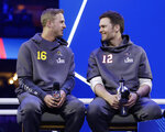 Los Angeles Rams' Jared Goff talks to New England Patriots' Tom Brady during Opening Night for the NFL Super Bowl 53 football game Monday, Jan. 28, 2019, in Atlanta. (AP Photo/Matt Rourke)