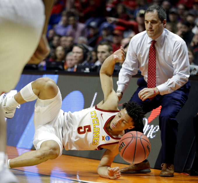 Iowa State's Lindell Wigginton crashes into the Iowa State bench in front of Iowa State head coach Steve Prohm during the first half of a first round men's college basketball game against Ohio State in the NCAA Tournament Friday, March 22, 2019, in Tulsa, Okla. (AP Photo/Charlie Riedel)