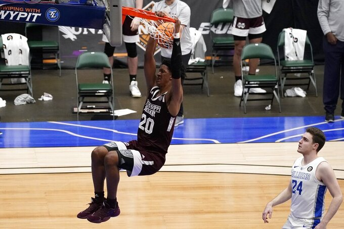 Mississippi State forward Derek Fountain (20) dunks the ball after getting past Saint Louis guard Gibson Jimerson (24) during the second half of an NCAA college basketball game in the first round of the NIT Tournament, Saturday, March 20, 2021, in Frisco, Texas. (AP Photo/Tony Gutierrez)