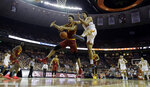 Iowa State forward George Conditt IV (4) and Texas forward Jericho Sims (20) scramble for a rebound during the second half of an NCAA college basketball game, Saturday, March 2, 2019, in Austin, Texas. (AP Photo/Eric Gay)