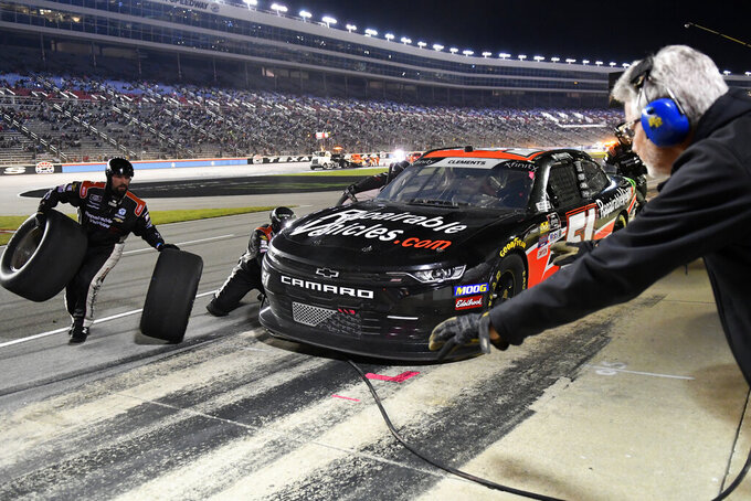 Jeremy Clements has his vehicle serviced during a NASCAR Xfinity auto race at Texas Motor Speedway in Fort Worth, Texas, Saturday, Nov. 2, 2019. (AP Photo/Larry Papke)