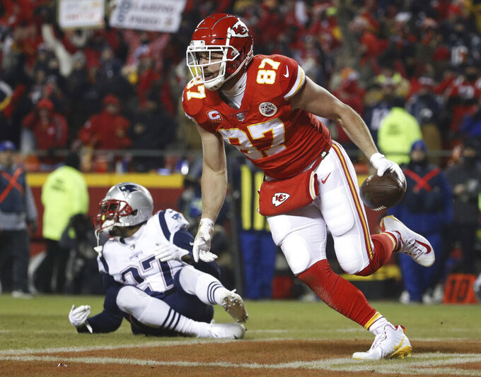 Kansas City Chiefs tight end Travis Kelce (87) celebrates his touchdown reception against the New England Patriots during the second half of the AFC Championship NFL football game, Sunday, Jan. 20, 2019, in Kansas City, Mo. (AP Photo/Charlie Riedel)