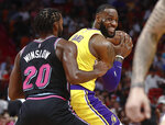 Los Angeles Lakers forward LeBron James keeps the ball from Miami Heat forward Justise Winslow during the first half of an NBA basketball game Sunday, Nov. 18, 2018, in Miami. (AP Photo/Brynn Anderson)
