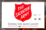In this Friday, Nov. 15, 2019, photo, two ways to donate via Apple Pay and Google Pay to the Salvation Army's annual holiday red kettle campaign are incorporated next to the Army's iconic red shield on Chicago's Magnificent Mile. Cashless shoppers have a new option to give to the Army's red kettle campaign this year using their smartphone. Leaders hope adding Apple and Google payment options will boost fundraising to the campaign, which makes up 10% of The Salvation Army's annual budget. Those donations fund programs providing housing, food and other support to people in poverty. (AP Photo/Charles Rex Arbogast)
