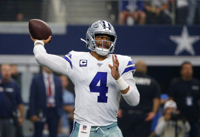 Dallas Cowboys quarterback Dak Prescott (4) throws a pass in the first half of a NFL football game against the New York Giants in Arlington, Texas, Sunday, Sept. 8, 2019. (AP Photo/Michael Ainsworth)