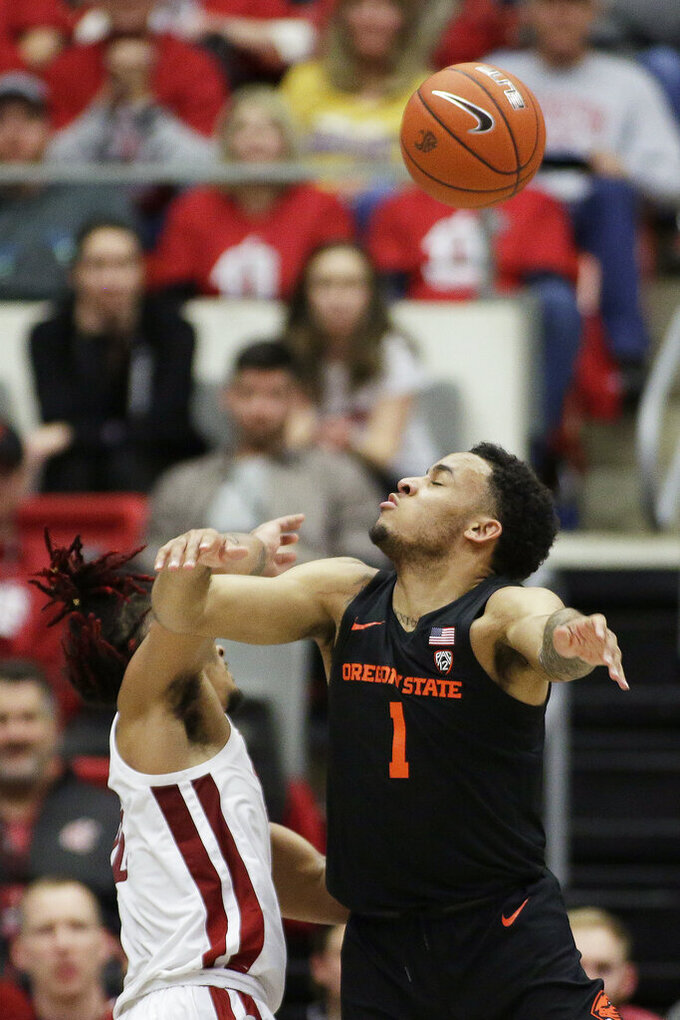 Oregon State guard Sean Miller-Moore, right, and Washington State guard Isaac Bonton go after the ball during the second half of an NCAA college basketball game in Pullman, Wash., Saturday, Jan. 18, 2020. Washington State won 89-76. (AP Photo/Young Kwak)