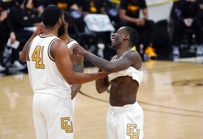 Colorado forward Jeriah Horne, left, congratulates guard McKinley Wright IV as time runs out in the second half of an NCAA college basketball game against Arizona State, Thursday, March 4, 2021, in Boulder, Colo. (AP Photo/David Zalubowski)