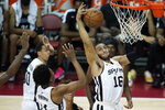 San Antonio Spurs' Stephen Domingo, right, grabs a rebound against the Brooklyn Nets during the first half of an NBA summer league basketball game Sunday, Aug. 15, 2021, in Las Vegas. (AP Photo/John Locher)