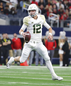 Baylor quarterback Charlie Brewer (12) scrambles against Texas Tech in the first half of an NCAA college football game Saturday, Nov. 24, 201 in Arlington, Texas. (Jerry Larson/Waco Tribune-Herald via AP)