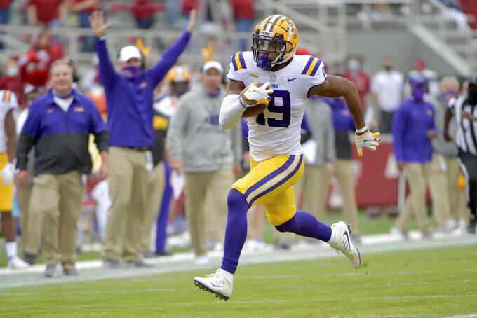 LSU defensive back Jabril Cox returns an interception against Arkansas during the first half of an NCAA college football game Saturday, Nov. 21, 2020, in Fayetteville, Ark. (AP Photo/Michael Woods)