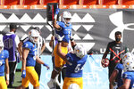 San Jose State offensive lineman Jaime Navarro (54) holds up wide receiver Isaiah Holiness (1) after Holiness made a touchdown against Hawaii in the first half of an NCAA college football game Saturday, Dec. 5, 2020, in Honolulu. (AP Photo/Marco Garcia)