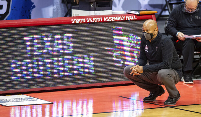 Texas Southern head coach Johnny Jones watches the action on the court during the first half of a First Four game against Mount St. Mary's in the NCAA men's college basketball tournament, Thursday, March 18, 2021, in Bloomington, Ind. (AP Photo/Doug McSchooler)