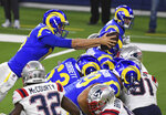 Los Angeles Rams Quarterback Jared Goff, left, dives for the touchdown against the New England Patriots during the first half of an NFL football game, Thursday, Dec. 10, 2020 in Inglewood, Calif.  (Keith Birmingham/The Orange County Register via AP)