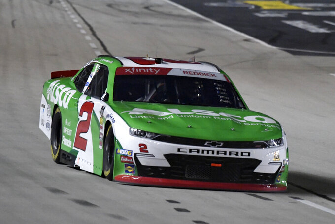 Tyler Reddick heads into Turn 1 during NASCAR Xfinity auto race at Texas Motor Speedway in Fort Worth, Texas, Saturday, Nov. 2, 2019. (AP Photo/Larry Papke)