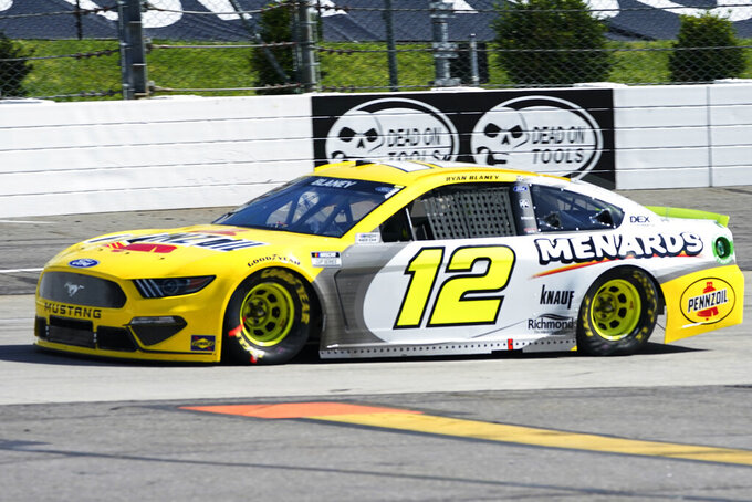 Ryan Blaney (12) drives into turn two during the NASCAR Cup Series auto race at Martinsville Speedway in Martinsville, Va., Sunday, April 11, 2021. (AP Photo/Steve Helber)