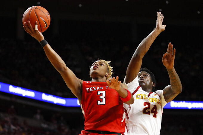 FILE - In this Feb. 22, 2020, file photo, Texas Tech guard Jahmi'us Ramsey (3) drives to the basket ahead of Iowa State guard Terrence Lewis (24) during the second half of an NCAA college basketball game in Ames, Iowa. Ramsey was selected the Associated Press Big 12 Newcomer of the Year, Tuesday, March 10, 2020. (AP Photo/Charlie Neibergall, File)