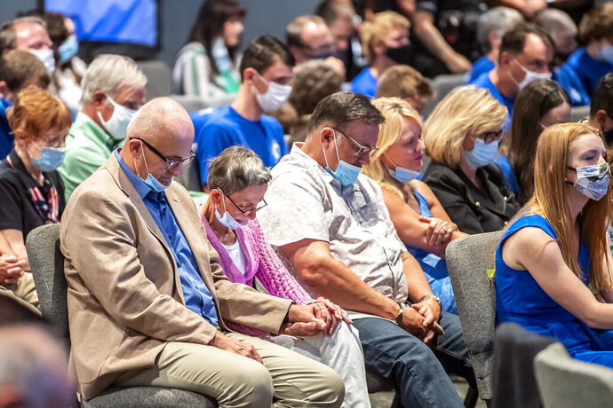 FILE—In this file photo from Sept. 9, 2020, people attending an event with Vice President Mike Pence, pray before he took the stage to speak to Marjorie Dannenfelser, president of the Susan B. Anthony List, an anti-abortion group, at Cornerstone Ministries church, in Export, Pa. a Pittsburgh suburb. Trump's selection of Mike Pence to be his vice president has often been cited as a turning point in getting evangelicals, who make up about 1 in 5 voters, to rally behind Trump four years ago. (Alexandra Wimley/Pittsburgh Post-Gazette via AP, File)