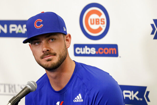 Chicago Cubs third baseman Kris Bryant speaks to reporters during spring training baseball Saturday, Feb. 15, 2020, in Mesa, Ariz. (AP Photo/Gregory Bull)