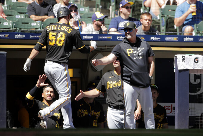 Pittsburgh Pirates' Jacob Stallings (58) is congratulated in the dugout after hitting a solo home run during the sixth inning of a baseball game against the Milwaukee Brewers, Sunday, June 13, 2021, in Milwaukee. (AP Photo/Aaron Gash)