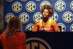 Tennessee's Jazmine Massengill, right, answers questions from her coach Kellie Harper during the Southeastern Conference NCAA college basketball media day, Thursday, Oct. 17, 2019, in Birmingham, Ala. (AP Photo/Butch Dill)