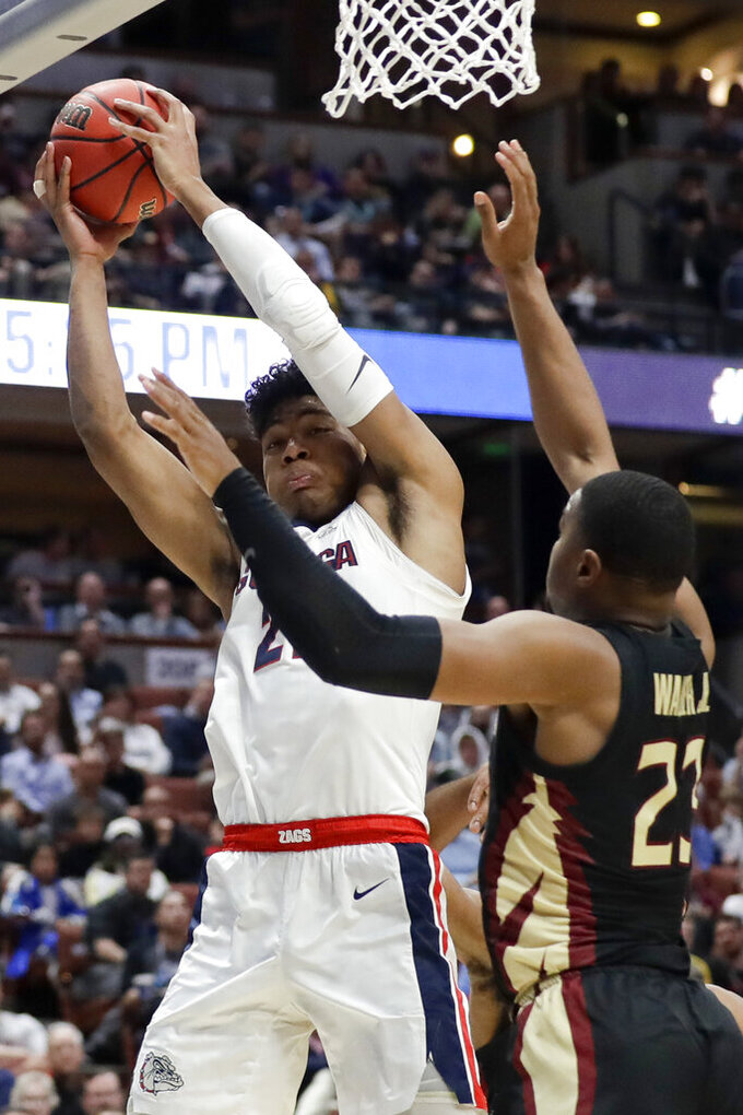 Gonzaga forward Rui Hachimura, left, vies for a rebound with Florida State guard M.J. Walker during the second half an NCAA men's college basketball tournament West Region semifinal Thursday, March 28, 2019, in Anaheim, Calif. (AP Photo/Marcio Jose Sanchez)
