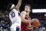 Saint Joseph's guard Ryan Daly (1) is guarded by Connecticut's Brendan Adams (10) in the second half of an NCAA college basketball game Wednesday, Nov. 13, 2019, in Storrs, Conn. Daly had a game-high 30 points. (AP Photo/Stephen Dunn)