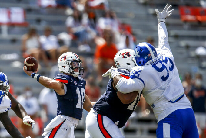 Auburn quarterback Bo Nix (10) throws a pass during the third quarter of an NCAA college football game against Kentucky on Saturday, Sept. 26, 2020, in Auburn, Ala. (AP Photo/Butch Dill)