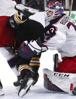 Boston Bruins left wing Jake DeBrusk is upended in front of Columbus Blue Jackets goaltender Sergei Bobrovsky (72) during the second period of Game 2 of an NHL hockey second-round playoff series, Saturday, April 27, 2019, in Boston. (AP Photo/Charles Krupa)