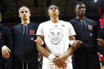 Rutgers guard Ron Harper Jr., center, tears up as he stands with teammates during a moment of silence in memory of former Los Angeles Laker Kobe Bryant, before Rutgers' NCAA college basketball game against Purdue, Tuesday, Jan. 28, 2020, in Piscataway, N.J. (AP Photo/Kathy Willens)