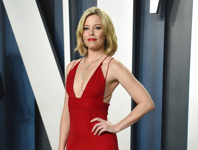 FILE - In this Feb. 9, 2020 file photo, actress Elizabeth Banks arrives at the Vanity Fair Oscar Party in Beverly Hills, Calif. Banks will play the manic science teacher Ms. Frizzle in a live-action film
