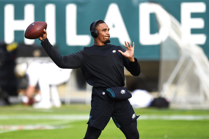 Philadelphia Eagles' Jalen Hurts warms up before an NFL football game against the New Orleans Saints, Sunday, Dec. 13, 2020, in Philadelphia. (AP Photo/Derik Hamilton)