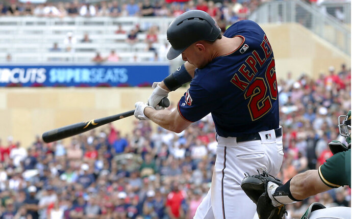 Minnesota Twins' Max Kepler follows through on his walkoff RBI-single off Oakland Athletics pitcher Liam Hendriks in the ninth inning of a baseball game Sunday, July 21, 2019, in Minneapolis. (AP Photo/Jim Mone)