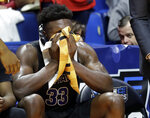 Buffalo's Nick Perkins wipes his face as he sits on the bench with less than a minute to go during the second half of a second round men's college basketball game against Texas Tech in the NCAA Tournament Sunday, March 24, 2019, in Tulsa, Okla. Texas Tech won 78-58. (AP Photo/Jeff Roberson)