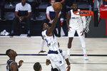 Dallas Mavericks forward Dorian Finney-Smith (10) shoots against the Sacramento Kings in the first half of an NBA basketball game Tuesday, Aug. 4, 2020, in Lake Buena Vista, Fla. (Kim Klement/Pool Photo via AP)