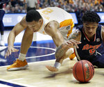 Tennessee's Grant Williams (2) and Auburn's Chuma Okeke (5) dive after a loose ball in the second half of the NCAA college basketball Southeastern Conference championship game Sunday, March 17, 2019, in Nashville, Tenn. (AP Photo/Mark Humphrey)