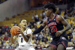 Missouri's Xavier Pinson (1) heads to the basket as Georgia's Rayshaun Hammonds (20) defends during the second half of an NCAA college basketball game Tuesday, Jan. 28, 2020, in Columbia, Mo. Missouri won 72-69. (AP Photo/Jeff Roberson)