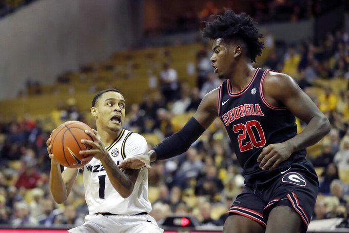 Missouri's Xavier Pinson (1) heads to the basket as Georgia's Rayshaun Hammonds (20) defends during the second half of an NCAA college basketball game Tuesday, Jan. 28, 2020, in Columbia, Mo. Missouri won 72-69. (AP Photo/Jeff Roberson)