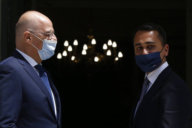 Greek Foreign Minister Nikos Dendias, left, welcomes his Italian counterpart Luigi Di Maio during their meeting at the Foreign Ministry in Athens, on Tuesday, June 9, 2020. (Costas Baltas /Pool via AP)