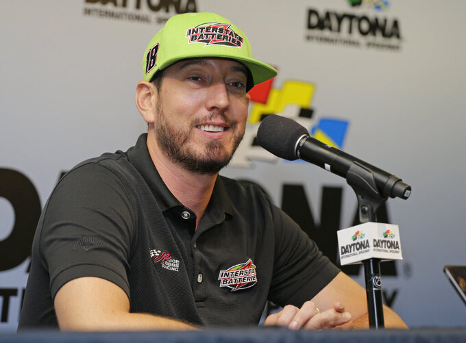 Kyle Busch talks with reporters during a NASCAR auto race news conference at Daytona International Speedway, Friday, July 5, 2019, in Daytona Beach, Fla. (AP Photo/Terry Renna)