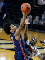 Auburn guard Sharife Cooper (2) shoots against Vanderbilt guard Trey Thomas (12) during the second half of an NCAA college basketball game Tuesday, Feb. 9, 2021, in Nashville, Tenn. Auburn won 73-67. (AP Photo/Mark Zaleski)