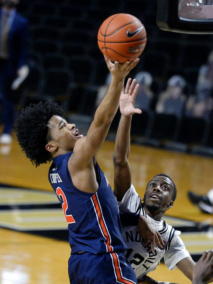 Auburn guard Sharife Cooper (2) shoots against Vanderbilt guard Trey Thomas (12) during the second half of an NCAA college basketball game Tuesday, Feb. 9, 2021, in Nashville, Tenn. Auburn won 73-67. (AP Photo/Mark Zaleski)