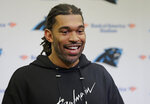 FILE - In this April 5, 2019, file photo, former Carolina Panthers defensive end Julius Peppers answers a question during a news conference in Charlotte, N.C. Josh Heupel, who was the Heisman Trophy runner-up for Oklahoma in 2000, and former North Carolina pass-rushing star Julius Peppers are among 12 players making their first appearance of the College Football Hall of Fame ballot this year. (AP Photo/Chuck Burton, File)
