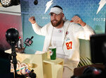 Kansas City Chiefs' Travis Kelce poses during Opening Night for the NFL Super Bowl 54 football game Monday, Jan. 27, 2020, at Marlins Park in Miami. (AP Photo/David J. Phillip)