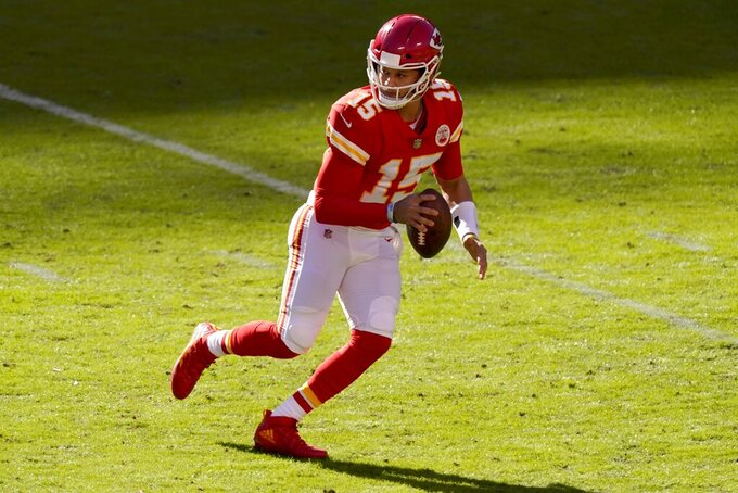 Kansas City Chiefs quarterback Patrick Mahomes rolls out of the pocket before throwing a pass in the second half of an NFL football game against the New York Jets on Sunday, Nov. 1, 2020, in Kansas City, Mo. (AP Photo/Charlie Riedel)
