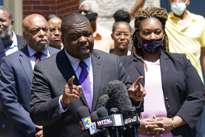 Attorney's for the family of Andrew Brown Jr., Harry Daniel, center, Chantel Cherry-Lassiter, right, and Wayne Kendall, left, make comments after a judge denied requests to release body camera video in the fatal shooting of Brown, in Elizabeth City, N.C., Wednesday, April 28, 2021. (AP Photo/Steve Helber)