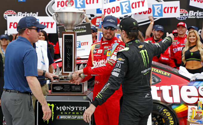 Kyle Busch gets a hug from brother Kurt Busch, right, after winning the NASCAR Cup Series auto race Sunday, April 7, 2019, in Bristol, Tenn.(AP Photo/Wade Payne)
