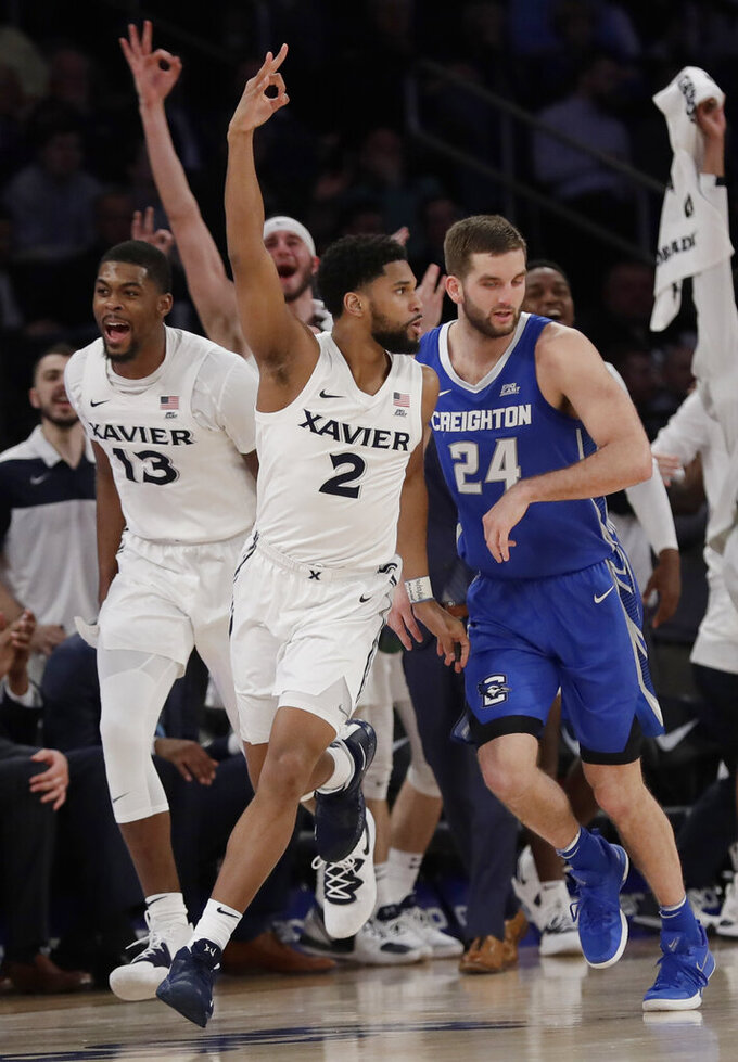 Xavier's Kyle Castlin (2) celebrates in front of Creighton's Mitch Ballock (24) after making a three-point basket during the second half of an NCAA college basketball game in the Big East men's tournament Thursday, March 14, 2019, in New York. (AP Photo/Frank Franklin II)