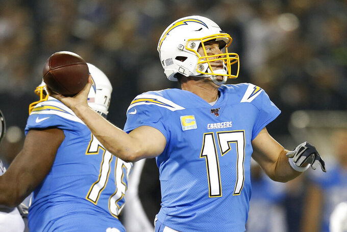 Los Angeles Chargers quarterback Philip Rivers throws a pass against the Oakland Raiders during the first half of an NFL football game in Oakland, Calif., Thursday, Nov. 7, 2019. (AP Photo/D. Ross Cameron)